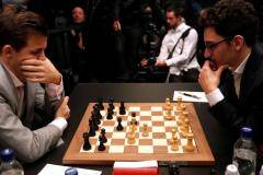 Магнус IV. Карлсен обыграл Каруану и защитил звание чемпиона мира