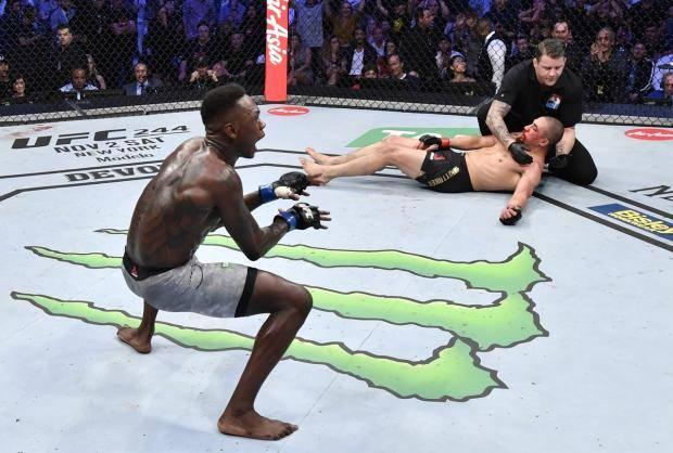 Адесанья вырубил Уиттакера и стал чемпионом. Лучшие моменты турнира UFC 243 (видео)